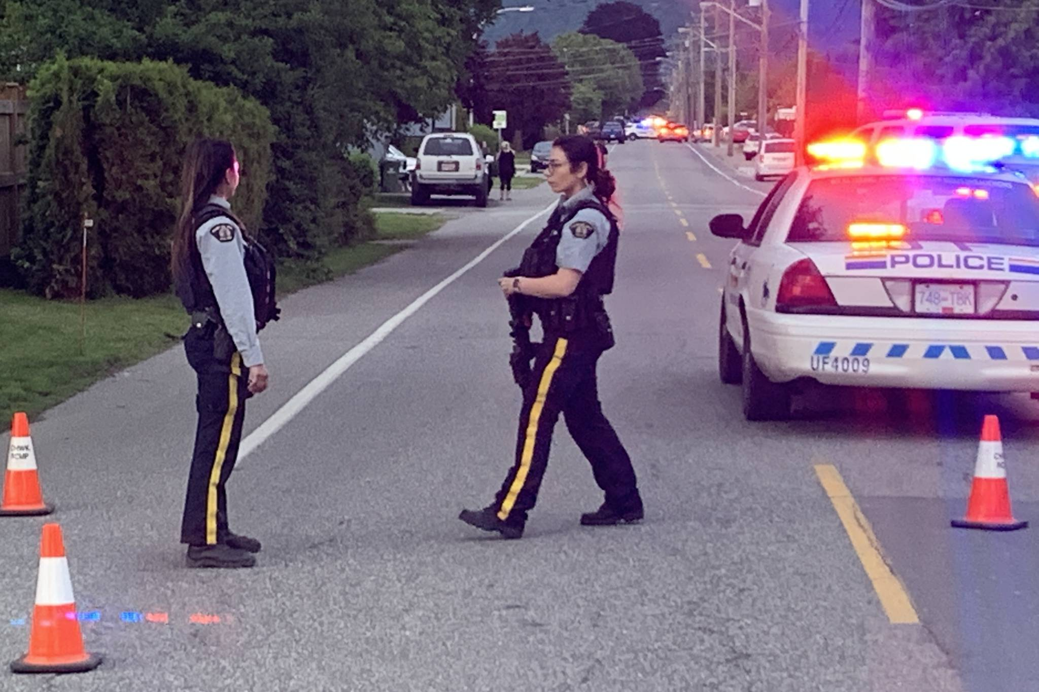 Chilliwack RCMP officers on the scene of a police incident involving shots fired, according to witnesses, near Christina Drive in Chilliwack on May 23, 2020. (Paul Henderson/ The Progress)
