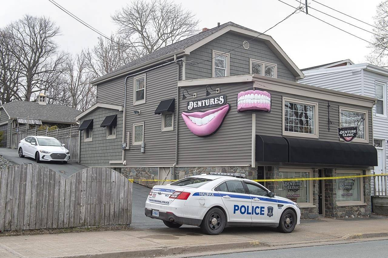 The Atlantic Denture Clinic is guarded by police in Dartmouth, N.S. on Monday, April 20, 2020. The repeated threats and isolation a Nova Scotia mass shooter allegedly used against his spouse show why such cruelty should be a criminal offence in Canada, experts on domestic violence say. Acquaintances and former neighbours have described the 51-year-old killer as a clever and manipulative millionaire who would threaten harm to his spouse's family, control her money or cut off her means of escape by removing the tires from her car or blocking the driveway. THE CANADIAN PRESS/Andrew Vaughan