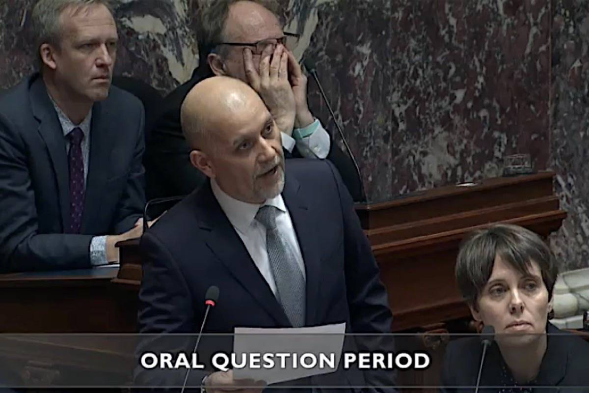 Oak Bay-Gordon Head MLA Andrew Weaver listens from his new seat as an independent MLA as interim B.C. Green Party leader Adam Olsen questions the NDP government in the B.C. legislature, Feb. 12, 2020. (Hansard TV)