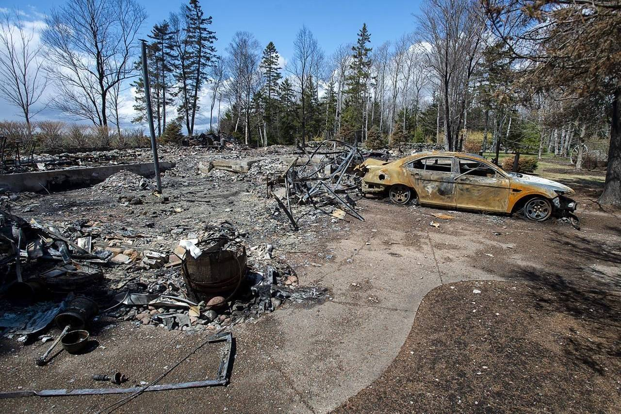 aA fire-destroyed property registered to Gabriel Wortman at 200 Portapique Beach Road is seen in Portapique, N.S. on Friday, May 8, 2020. A former neighbour of the gunman behind last month's mass shooting in Nova Scotia says she reported his domestic violence and cache of firearms to the RCMP years ago and ended up leaving the community herself due to fears of his violence.THE CANADIAN PRESS/Andrew Vaughan