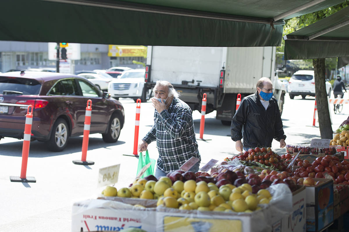 A part of the street is closed to traffic on Lonsdale Ave in North Vancouver, B.C. Tuesday, May 26, 2020. The partial street closures allow extra distance for pedestrians going past outdoor markets and restaurant patios during the COVID-19 pandemic. THE CANADIAN PRESS/Jonathan Hayward