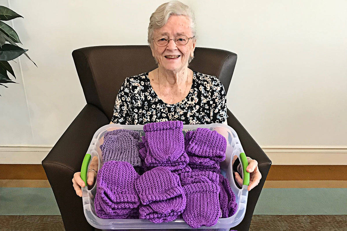 Mavis Kaschl has made more than 225 purple baby toques since the lockdown started in mid-March. (Langley Seniors Village photo/Special to the Langley Advance Times)