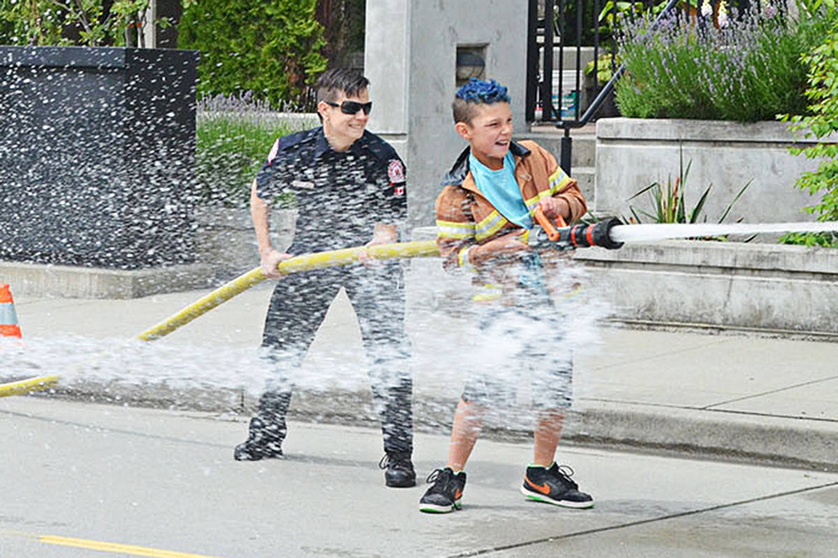 A firefighter challenge, giving kids a chance to work the fire hoses, has been a popular part of the Langley City Community Day festivities for years. (Langley Advance Times files)