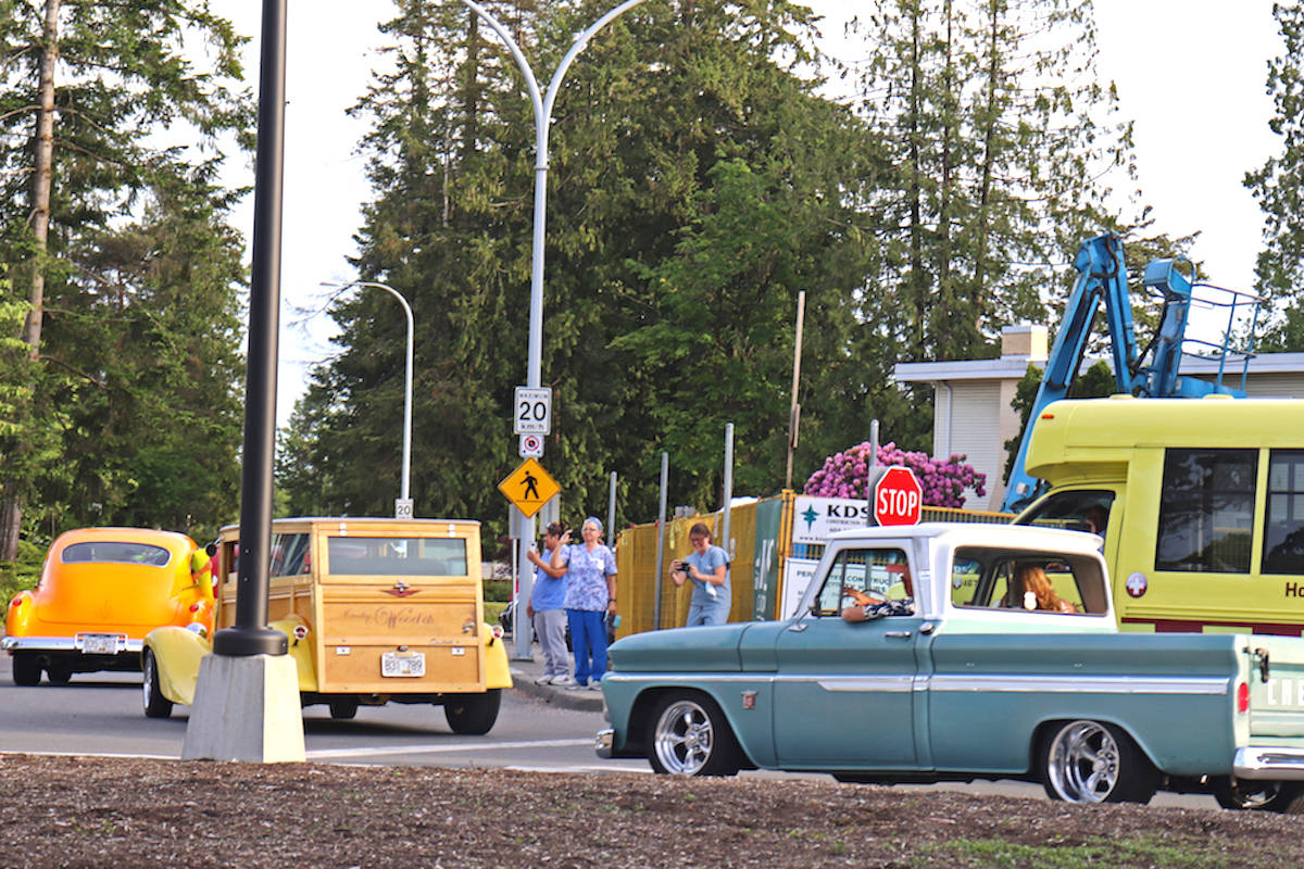 Hot rods parade by Langley hospital at seven o'clock for front line workers