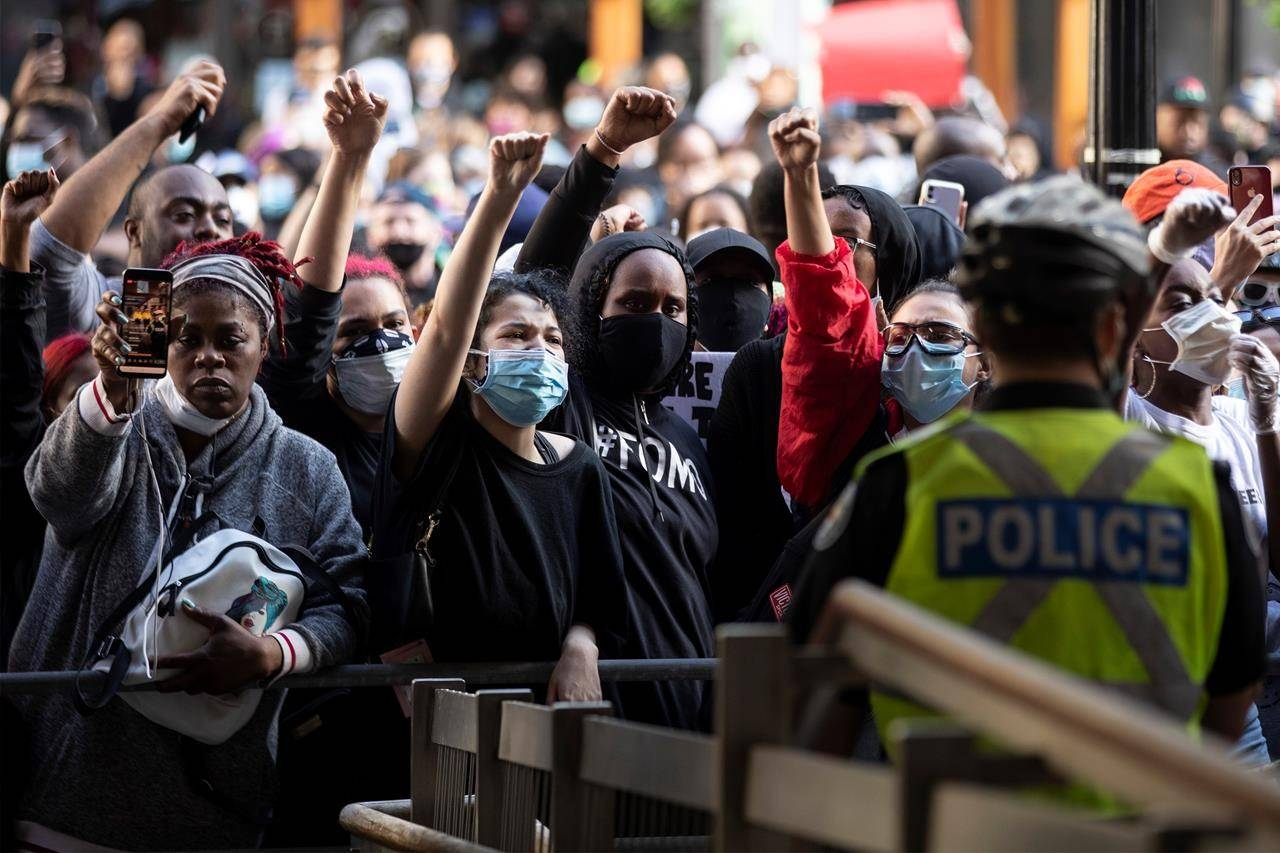 Demonstrators gather outside Toronto Police Headquarters after taking part in a rally protesting the death of Regis Korchinski-Paquet in downtown Toronto, Saturday May 30, 2020. Korchinski-Paquet, 29, fell from the balcony of a 24th-floor Toronto apartment while police were in the home. Thousands of protesters took to the streets to rally in the aftermath of high-profile, police-involved deaths in both Canada and the United States. THE CANADIAN PRESS/Chris Young