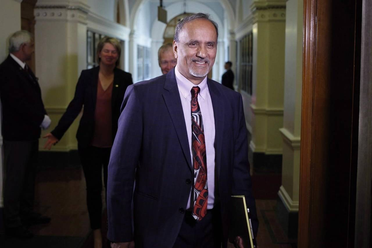 B.C. Labour Minister Harry Bains arrives at the start of the debate at B.C. Legislature in Victoria, B.C., on Monday, June 26, 2017. The minimum wage in B.C. is going up on Monday, rising to $14.60 per hour from $13.85. THE CANADIAN PRESS/Chad Hipolito
