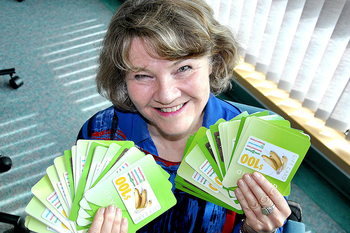 Susan Cairns, executive director of the Langley School District Foundation, flashes gift cards that will help feed local families amid COVID-19. (Susan Cairns/Special to the Langley Advance Times)