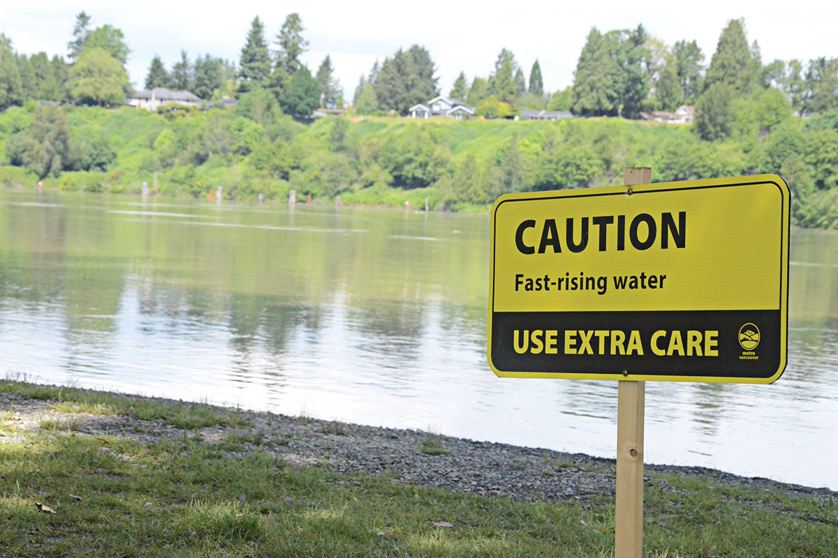 Signs warn visitors to Derby Reach Regional Park in Langley about the rising water levels. (Matthew Claxton/Langley Advance Times)