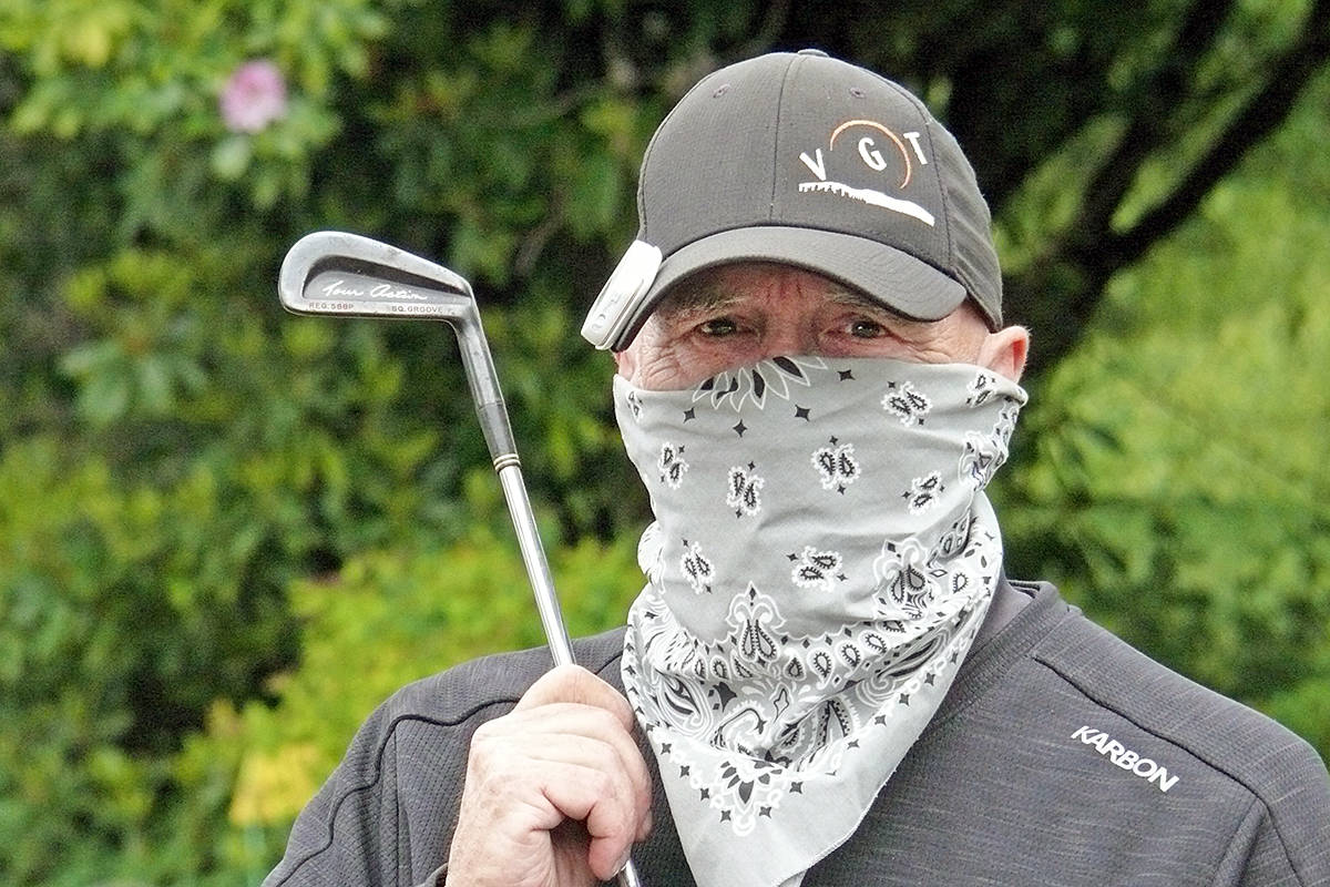 Murrayville golfer Greg Powell has taken to wearing a face covering when he golfs. The essential service worker said when he is well-separated from other golfers, he pulls it down. (Dan Ferguson/Langley Advance Times)