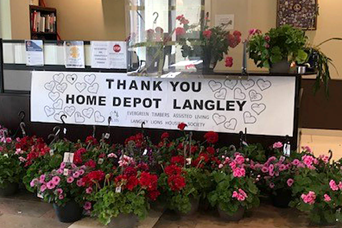 Home Depot Langley donated 60 hanging flower baskets to the Langley Lions Housing Society's Evergreen Timbers assisted living care facility last week, bringing smiles to many of the residents. (Special to Langley Advance Times)