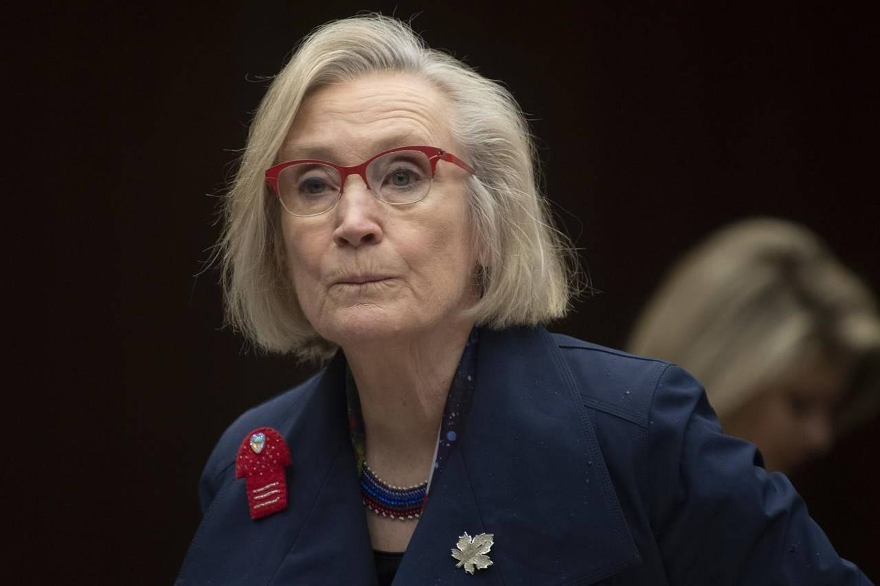 Crown-Indigenous Relations Minister Carolyn Bennett takes her seat as she wait to appear before the Indigenous and Northern Affairs committee in Ottawa on March 10, 2020. Disheartened, disappointed, disbelieving. But still determined. Indigenous women and leaders fighting to end violence against Indigenous women in Canada say that's how they feel about Wednesday's anniversary of the final report of the Inquiry into Missing and Murdered Indigenous Women and Girls. Families of victims who shared painful testimonies about the deaths and disappearances of their loved ones hoped their truths would spark immediate action and meaningful change. But Crown-Indigenous Relations Minister Carolyn Bennett's announcement last week that Ottawa is delaying its national action plan because of the COVID-19 pandemic has instead sparked widespread dismay.THE CANADIAN PRESS/Adrian Wyld