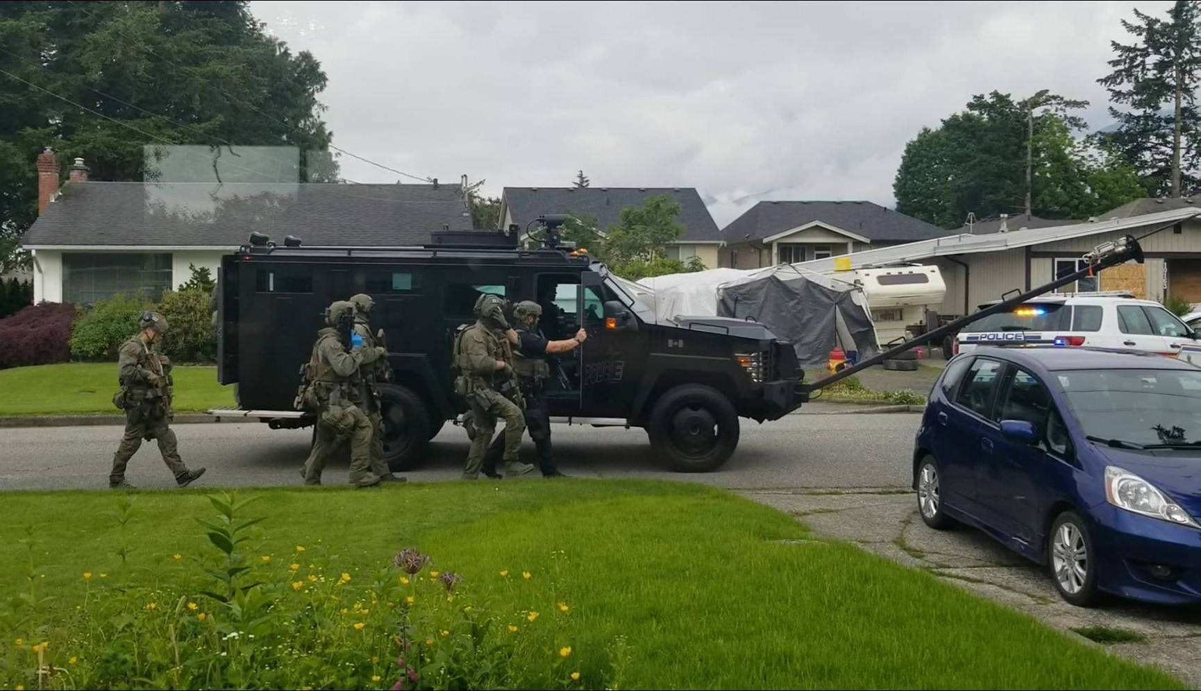 The Emergency Response Team sets up to approach a home on Fairview in Chilliwack on June 3, 2020. (Submitted)