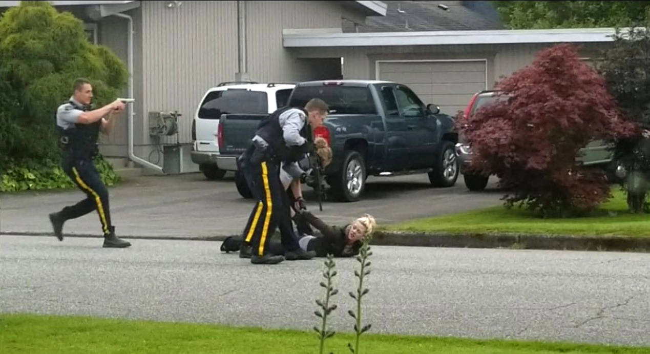 RCMP arrest a woman who was allegedly inside the home on June 3, 2020. (Submitted)