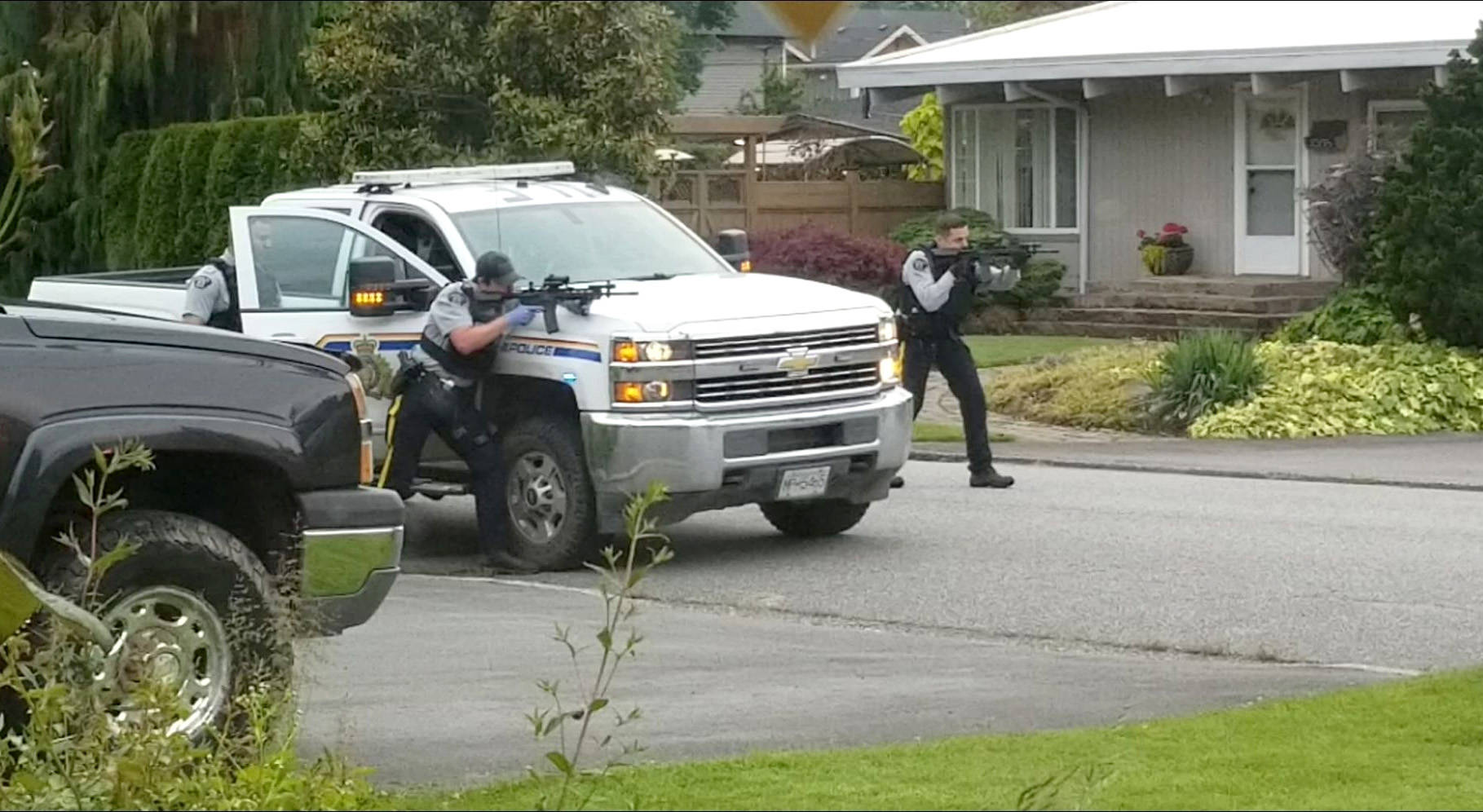 RCMP train their weapons on a home on Fairview Drive in Chilliwack on June 3, 2020. (Submitted)
