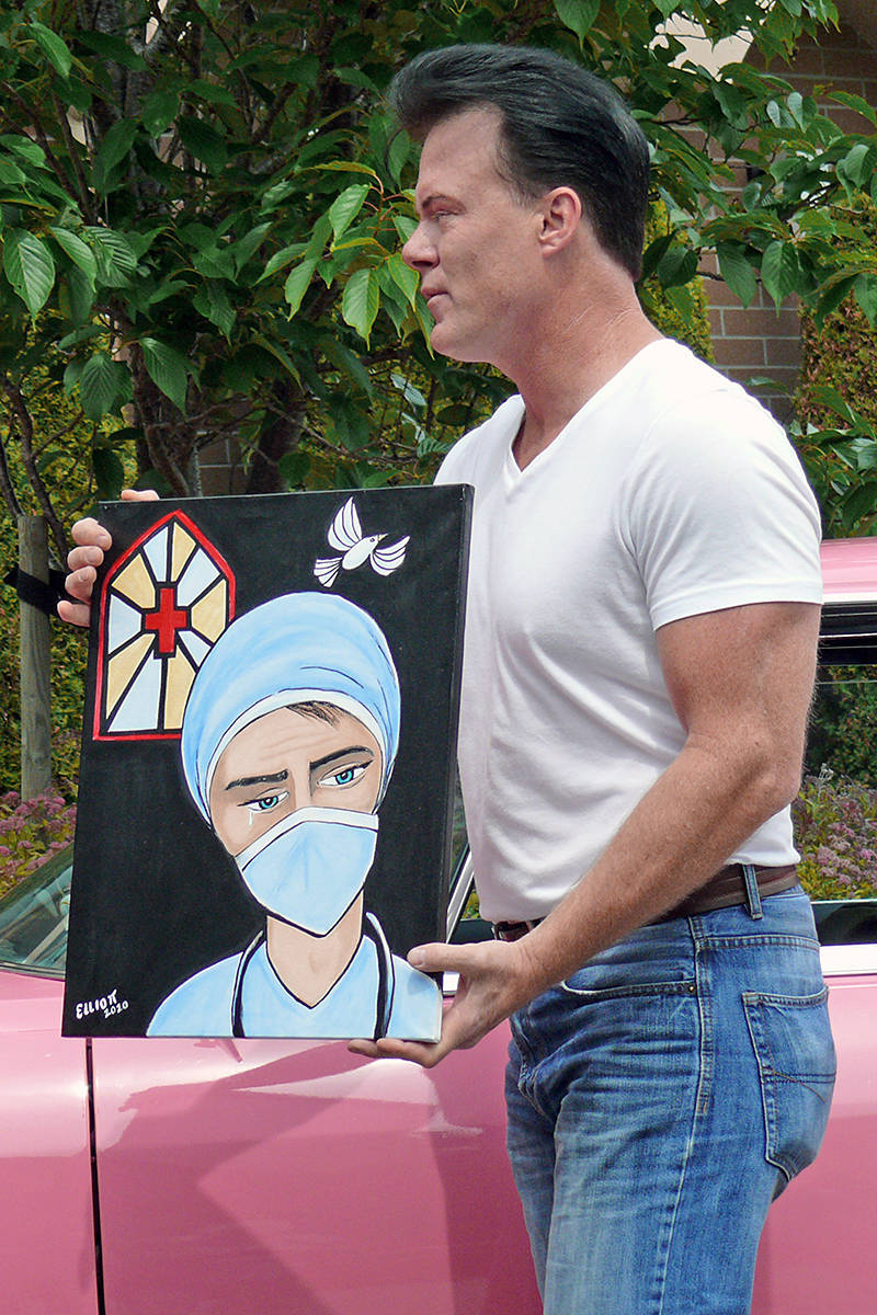 "Steve Elliot, better known as ""Elvis Elite,"" donated a painting to Langley Lodge at a the demonstration of support Wednesday, June 3 (Dan Ferguson/Langley Advance Times)"