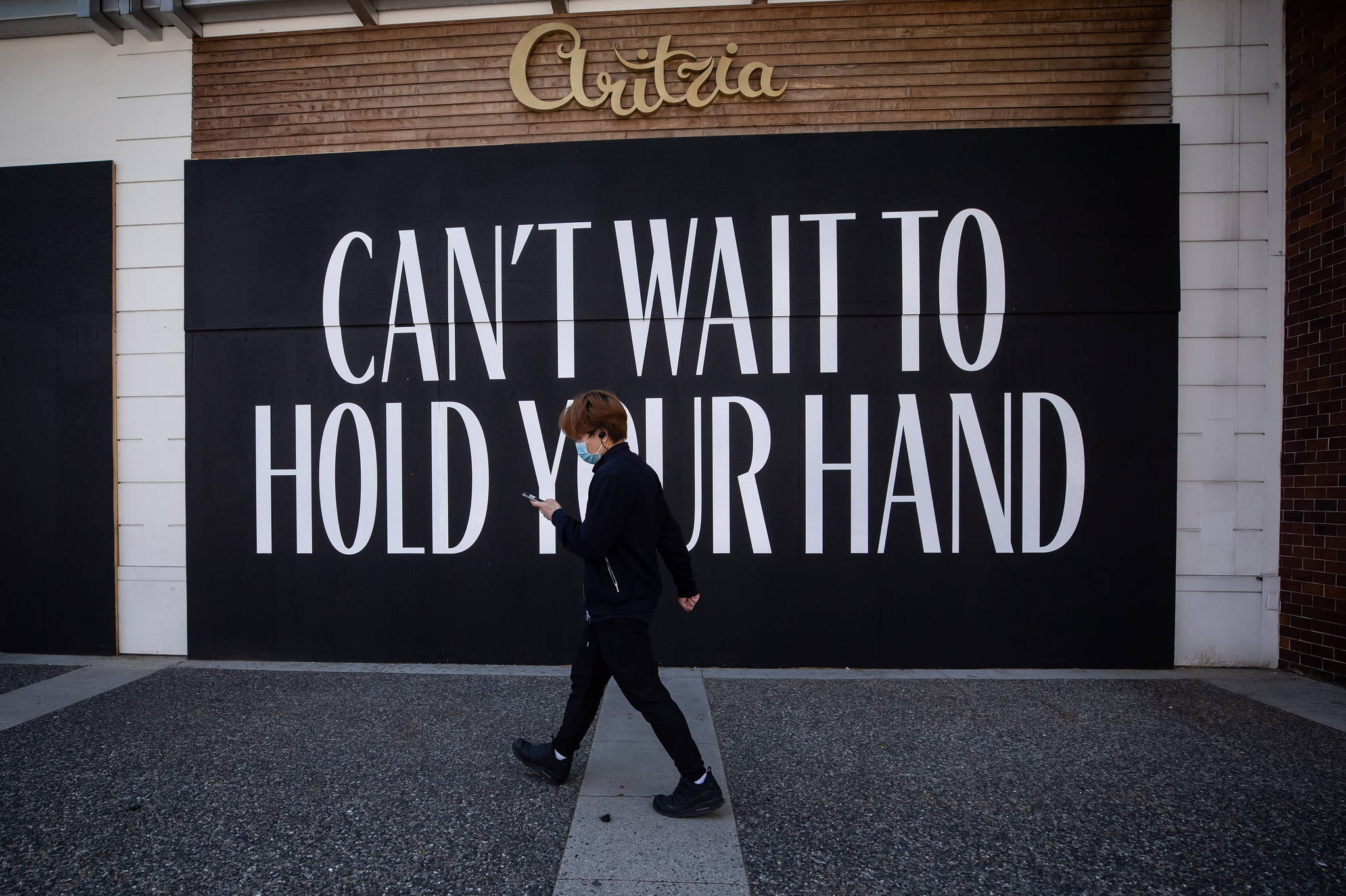 A message is painted on the boarded up windows of a closed Aritzia clothing store on Robson Street, in Vancouver, on Wednesday, May 6, 2020. Aritzia Inc. says it expects net revenue for its first quarter to be about 45 per cent lower than at the same time last year due to the impacts of COVID-19. THE CANADIAN PRESS/Darryl Dyck