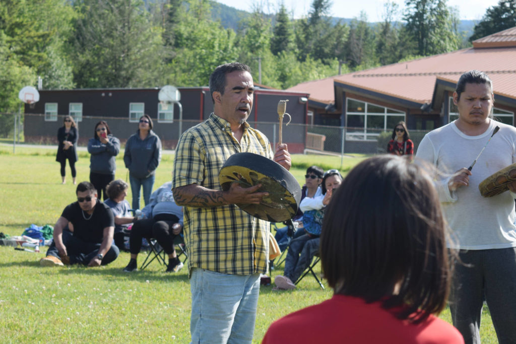 Aaron Watts of Tseshaht First Nation sings a song to remember Chantel Moore during a vigil at Haahuupayak School on Thursday, June 4. (ELENA RARDON / ALBERNI VALLEY NEWS)