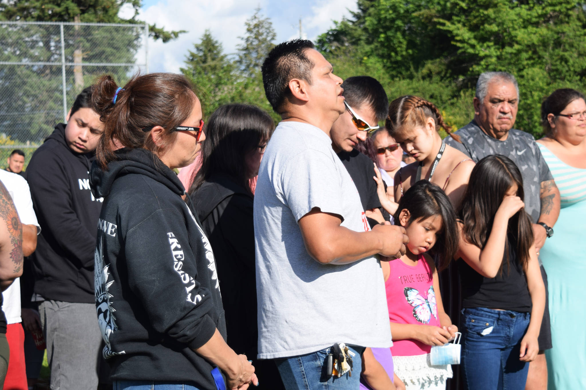 Kevin Titian (in white) speaks, remembering Chantel Moore, during a vigil at Haahuupayak School on Thursday, June 4. (ELENA RARDON / ALBERNI VALLEY NEWS)