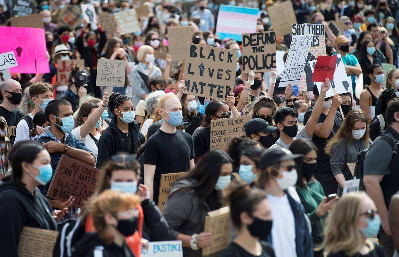 Thousands of people gather for a peaceful vigil in Vancouver, Friday, June 5, 2020 in solidarity with the George Floyd protests across the United States. THE CANADIAN PRESS/Jonathan Hayward