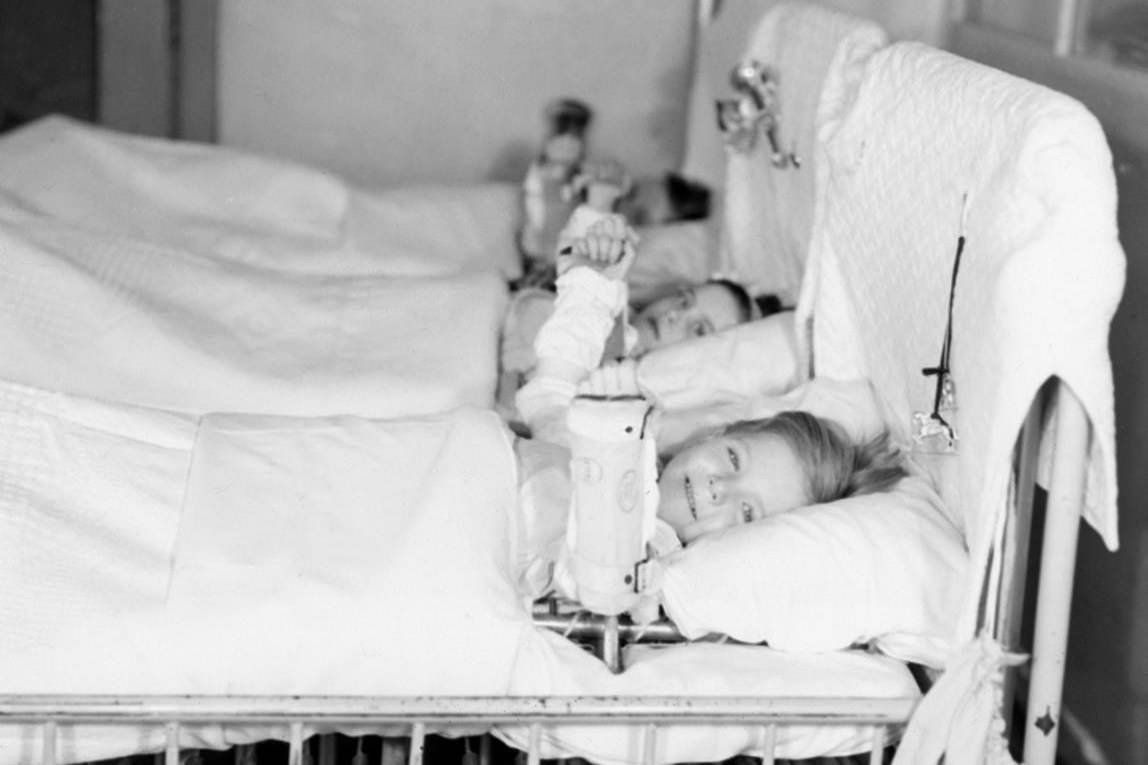 """Young girls are shown in the Polio girls' ward at Sick Kids Hospital in a 1937 handout photo in Toronto. The mystery illness that paralyzed and killed mostly children across Canada came in waves that built for nearly four decades before a vaccine introduced in 1955 put an end to the suffering. That was too late for 14-year-old Miki Boleen who contracted polio for a second time in 1953, perplexing doctors who believed """"the crippler"""" could not strike the same patient twice. Boleen, now 80, is hoping for a vaccine for COVID-19 as she reflects on the fear that spread with outbreaks of polio. THE CANADIAN PRESS/HO, Sick Kids Hospital *MANDATORY CREDIT*"""