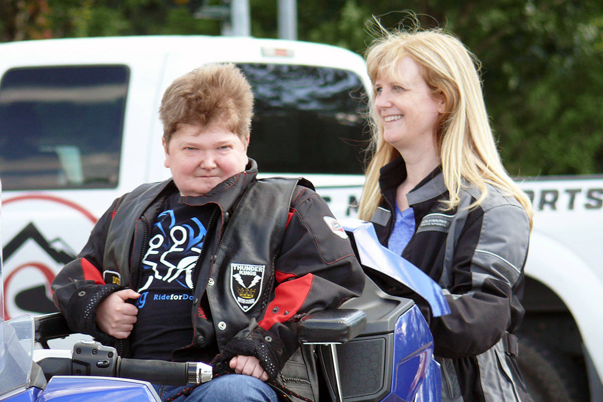 Doug Penner and his mom Allison awaited the start of the 2020 edition of the fundraising ride that bears his name, in the parking lot of the shuttered Walnut Grove Cineplex movie theatres on Sunday, June 7 (Dan Ferguson/Langley Advance Times)