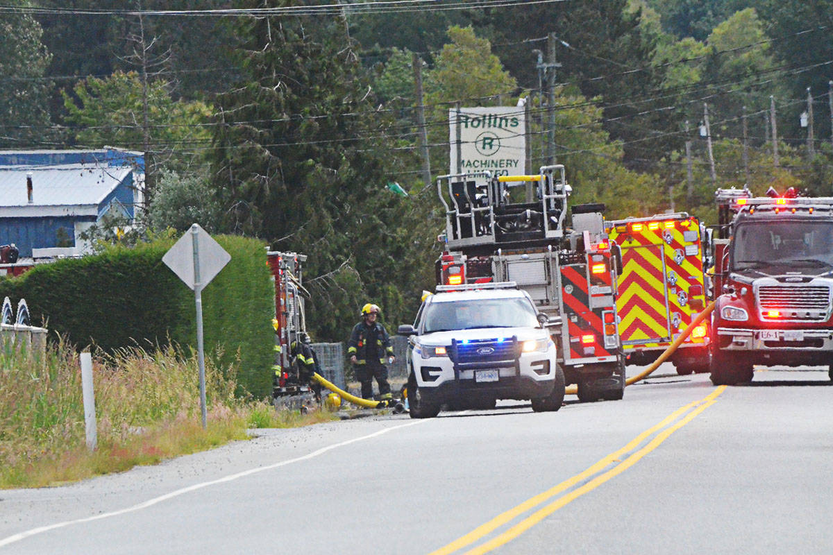 Fire crews and police were on scene at a fire on 56th Avenue just east of 216th Street on Monday morning. (Matthew Claxton/Langley Advance Times)