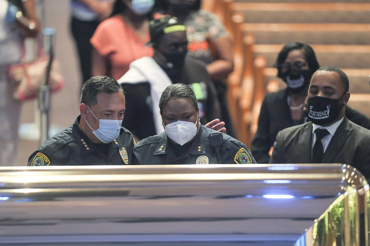 Houston Police Department chief Art Acevedo and assistant chief Sheryl Victorian visit the open casket of George Floyd during a public visitation Monday, June 8, 2020, at The Fountain of Praise church in Houston. (Godofredo A. Vásquez, Houston Chronicle via AP, Pool)