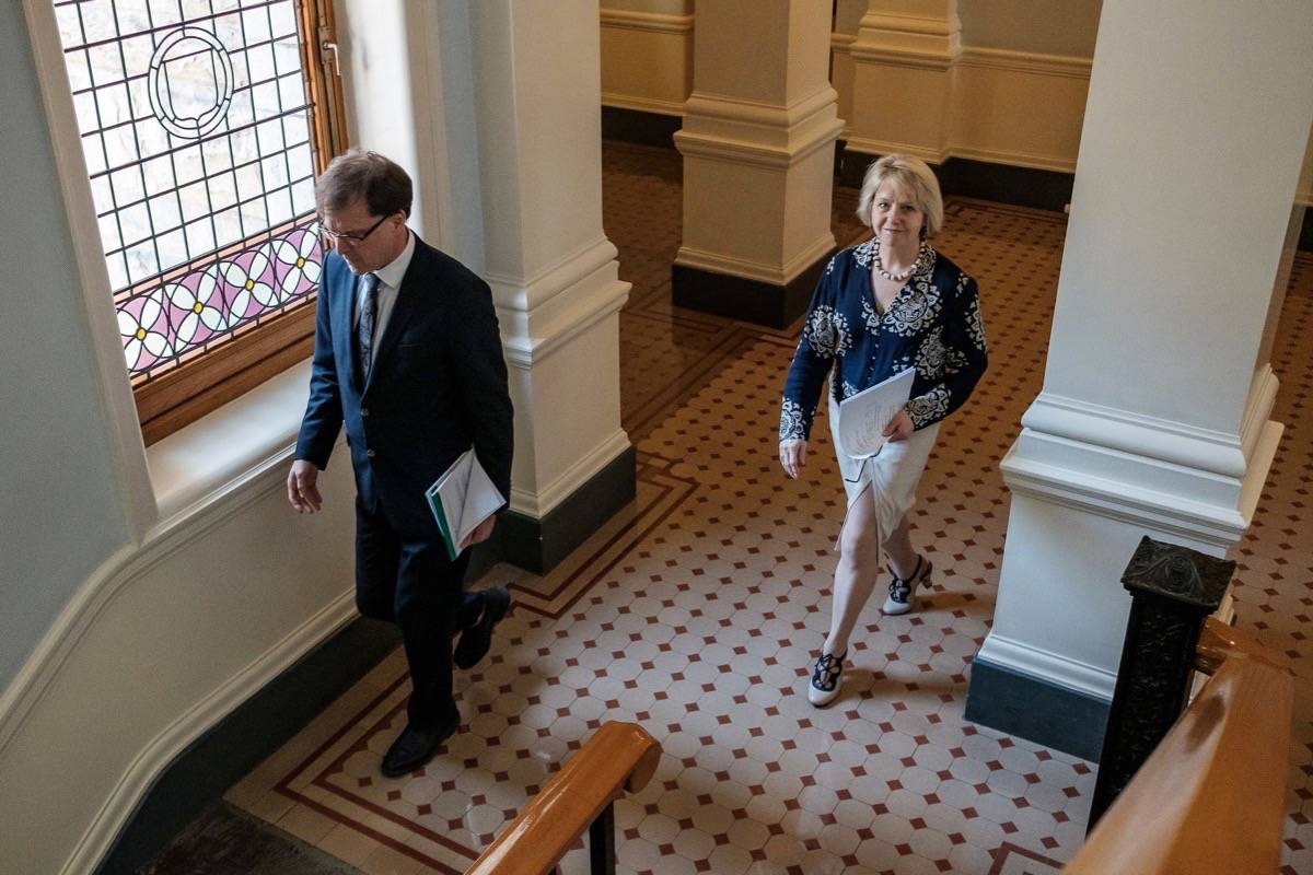 Provincial health officer Dr. Bonnie Henry and B.C. Health Minister Adrian Dix head to the press theatre at the B.C. legislature update the pandemic situation, June 1, 2020. (B.C. government)