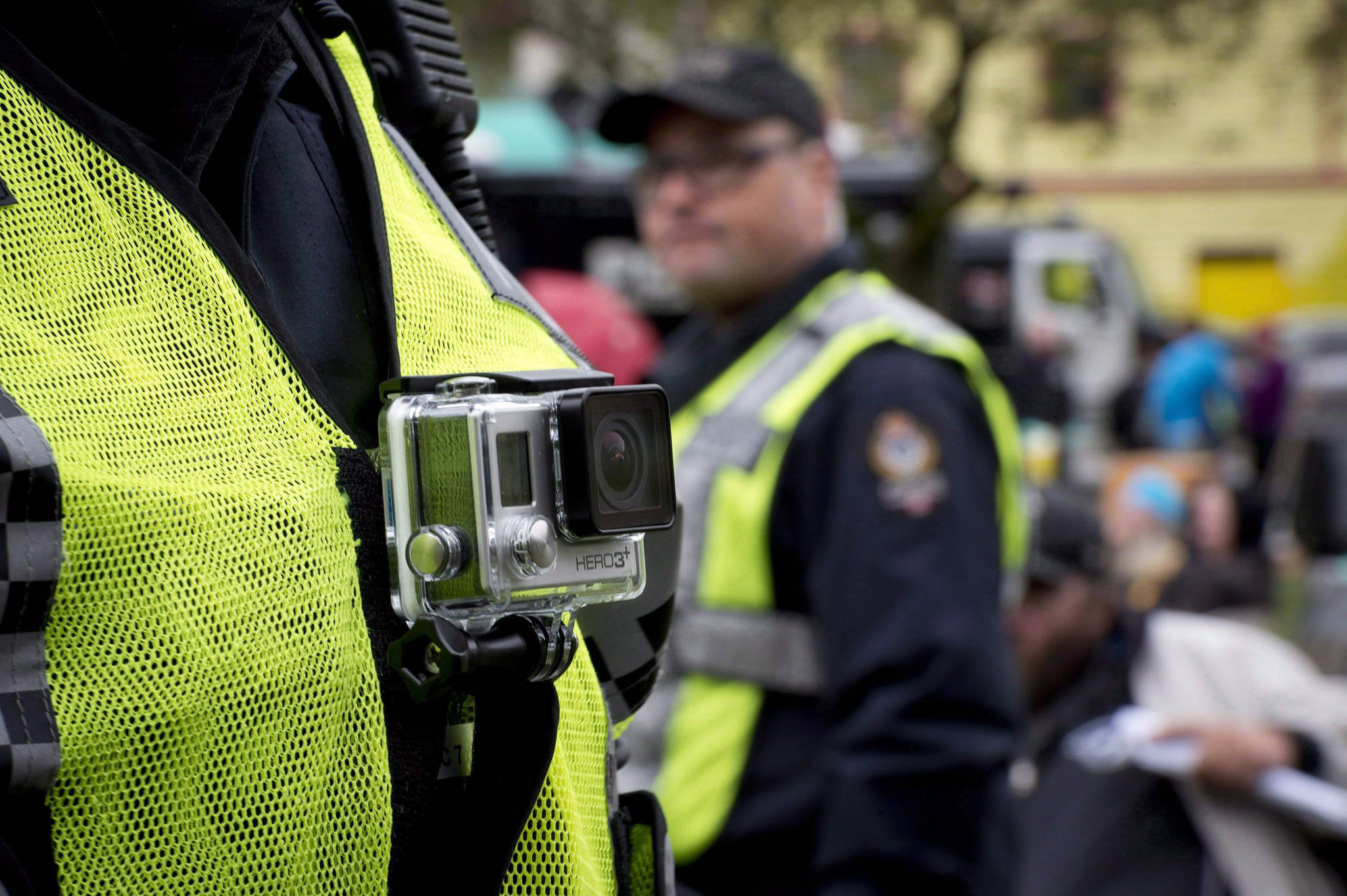 The mayor of Iqaluit is joining other Arctic leaders in a call to have RCMP members in Nunavut wear body cameras. A member of the Vancouver Police Department wears a chest mounted camera as he oversees the take down of a tent city in downtown Vancouver on Oct. 16, 2014. THE CANADIAN PRESS/Jonathan Hayward