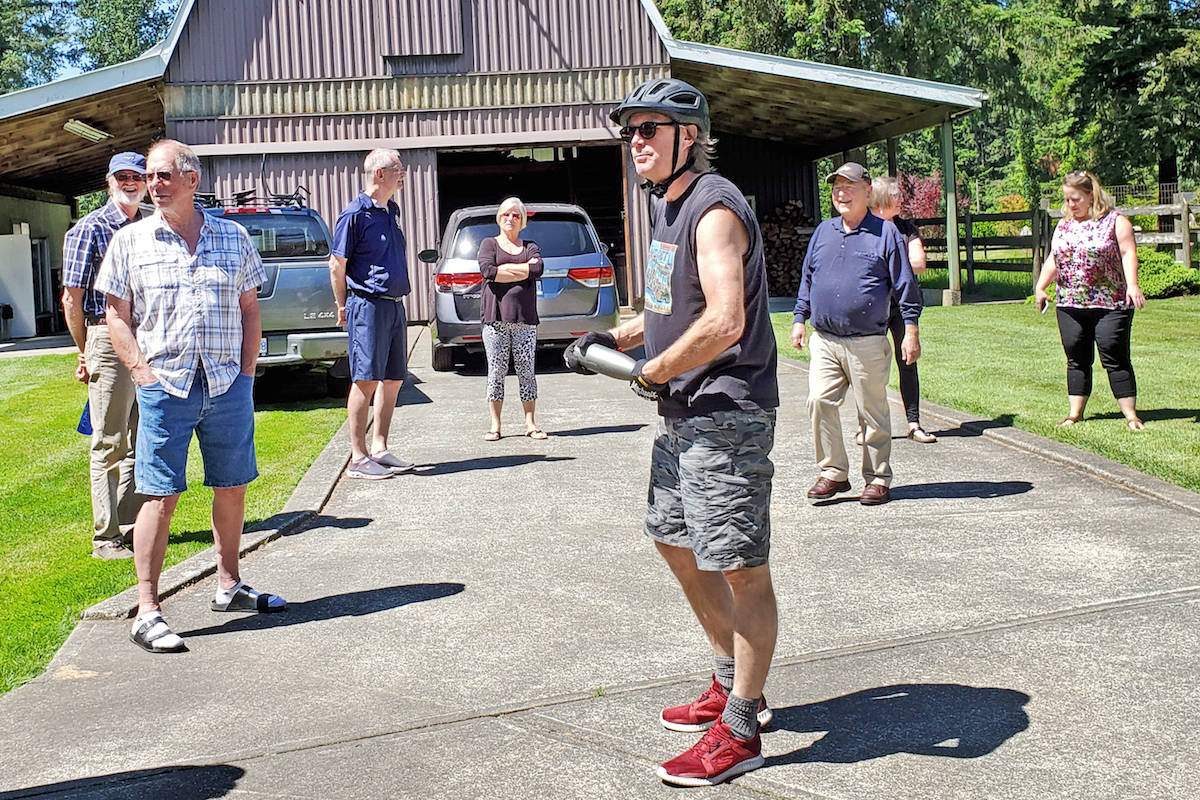 """After 23 Aldergrove Rotarians drove by to surprise friend Brian Thomasson (right) with """"get well"""" wishes on 272nd Street during lunchtime May 27, several of the club members got out of their cars to visit with the past president – from a safe social distance. (Cecelia Reekie/Special to the Star)"""