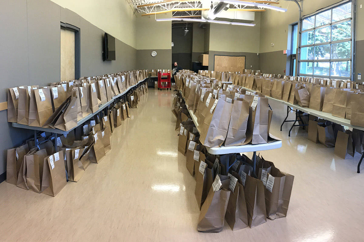 Hundreds of brown-bagged book holds sit ready to be picked up at the Sardis Library in Chilliwack. Starting June 1, the Fraser Valley Regional Library is offering curbside pick up at all 25 of its locations. (Submitted)