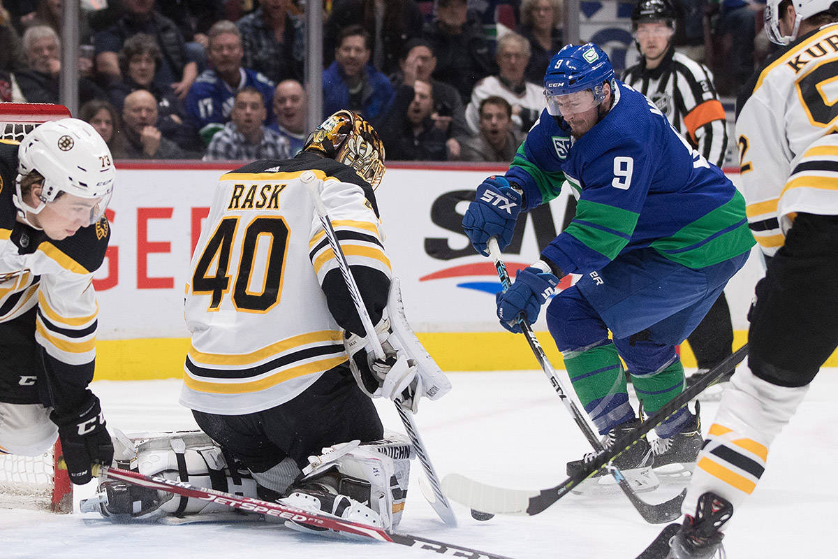 Boston Bruins goalie Tuukka Rask (40), of Finland, stops Vancouver Canucks' J.T. Miller (9) during the first period of an NHL hockey game in Vancouver, on Saturday, February 22, 2020. THE CANADIAN PRESS/Darryl Dyck
