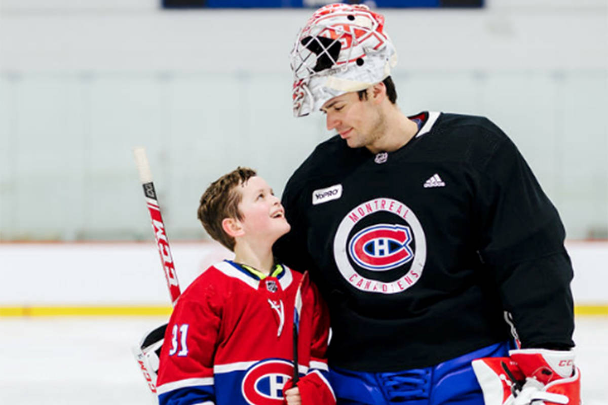 Williams Lake's Trey Felker looks up at Anahim Lake's Carey Price during a visit to the team's practice facility in Montreal earlier this spring. Felker was afforded the trip after being selected as one of three winners of the Breakfast Club of Canada and the Air Canada Foundation's Shooting for the Stars program. (Marï Photographe)