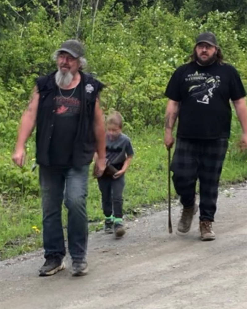 Wyatt Bednarz, left, his grandson Stryker and son Brad go in search of tools they used to ward a bear off attacking a baby calf. (Gail Bednarz photo)