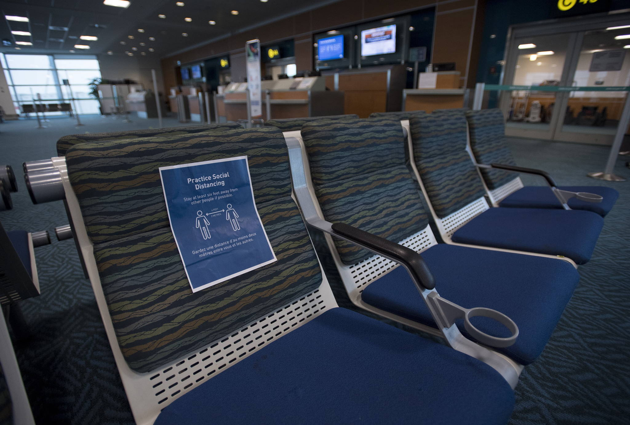 Near empty waiting areas at the flight gates are pictured at Vancouver International Airport, Tuesday, June 9, 2020. Airlines in Canada and around the world are suffering financially due to the lack of travel and travel bans due to COVID-19. THE CANADIAN PRESS/Jonathan Hayward