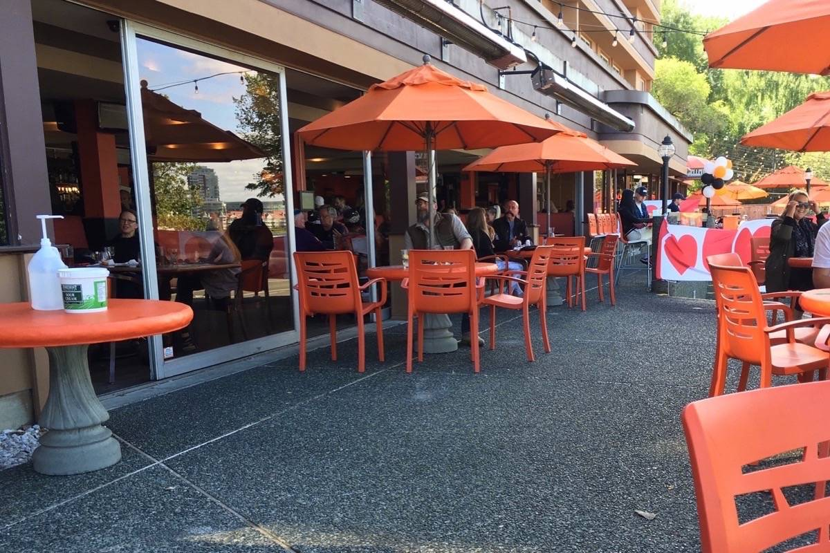 Pub patio in Victoria reopens with widely spaced tables, June 2020. (Tom Fletcher/Black Press)