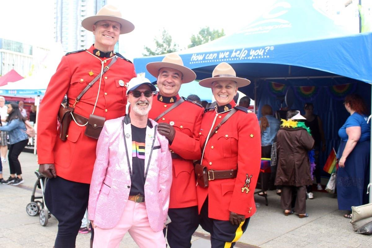Surrey Pride president Martin Rooney (front) poses with members of the Surrey RCMP, including spokesperson Corporal Elenore Sturko (right) at the 20th annual Surrey Pride at Central City Plaza on Saturday, June 29, 2019. (Photo: Lauren Collins)