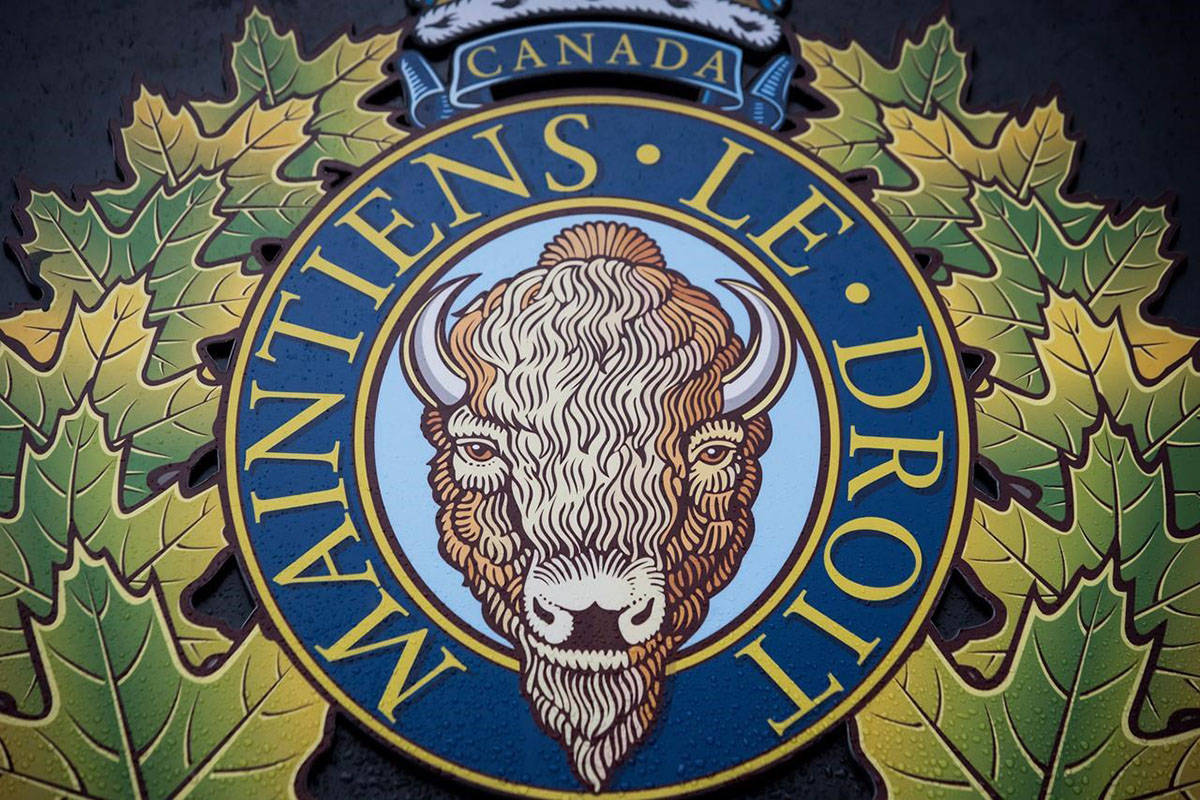 """The RCMP logo is seen outside Royal Canadian Mounted Police """"E"""" Division Headquarters, in Surrey, B.C., on Friday April 13, 2018. A civil lawsuit has been filed in B.C. Supreme Court over the death of a man in Whistler, B.C., alleging four RCMP officers used excessive force when they tried to take the man into custody. THE CANADIAN PRESS/Darryl Dyck"""