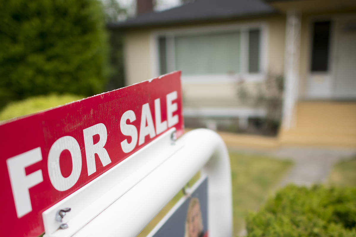FILE – A real estate sign is pictured in Vancouver, B.C., Tuesday, June, 12, 2018. THE CANADIAN PRESS/Jonathan Hayward