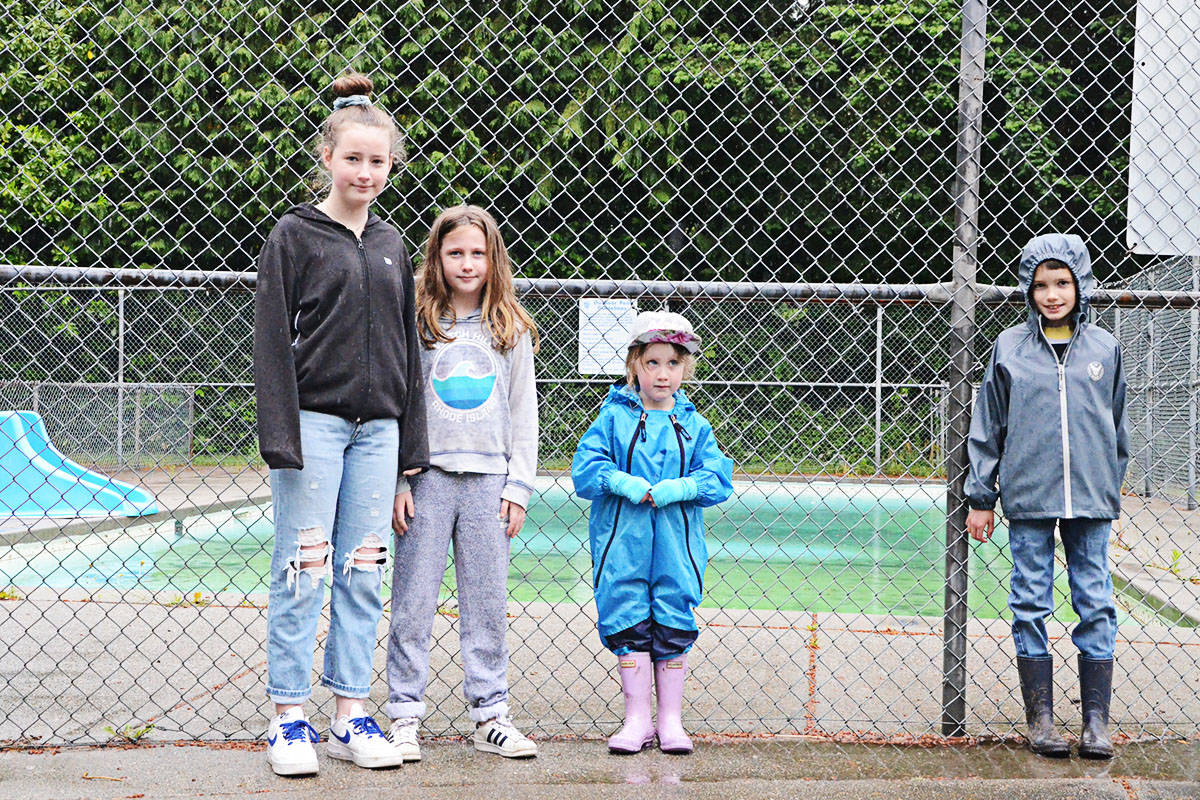 Nora Cashato, left, and other children from the Fort at the local outdoor pool. Cashato is hoping it can stay open rather than being turned into a spray park. (Langley Advance Times files)