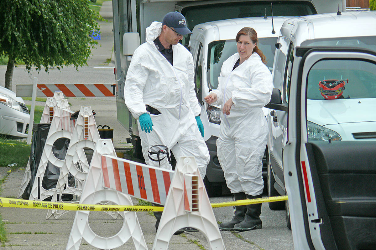 Forensic investigators remained on the scene June 16, 2020, of a fatal house fire in the 19600 block of Wakefield Drive in Langley (Dan Ferguson/Langley Advance Times)