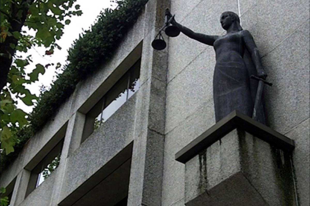Statue of Lady Justice outside courthouse, at B.C. Supreme Court in New Westminster. (Photo: Tom Zytaruk)