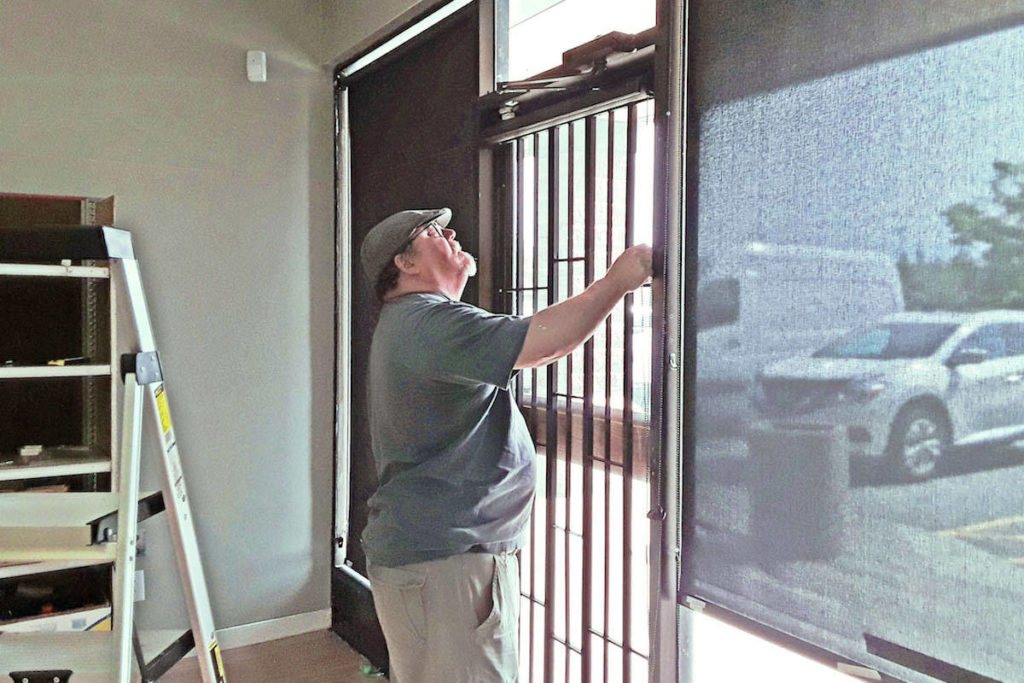 Jerry Peters and Les Valen of Aldergrove's Budget Blinds installed a new set of blinds and window coverings for the Aldergrove Food Bank, at no cost to the non-profit. (Aldergrove Food Bank/Special to the Star)