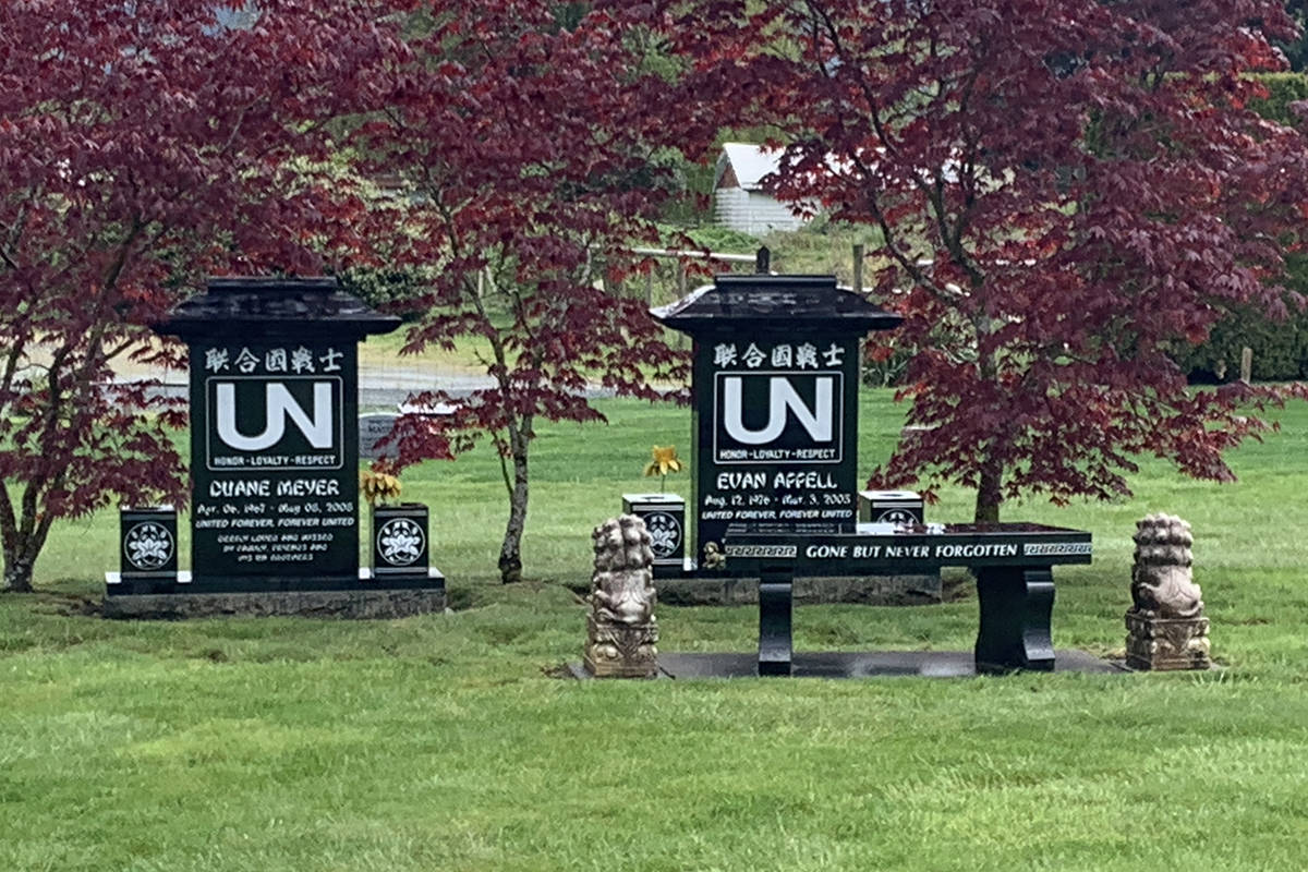 Two lion statues sit beside a bench at the grave sites of United Nations gang members Duane Meyer and Evan Appell on April 25, 2020 in Vedder View Gardens Cemetery in Chilliwack. Some time after that date, the statues went missing. (Paul Henderson/ The Progress)