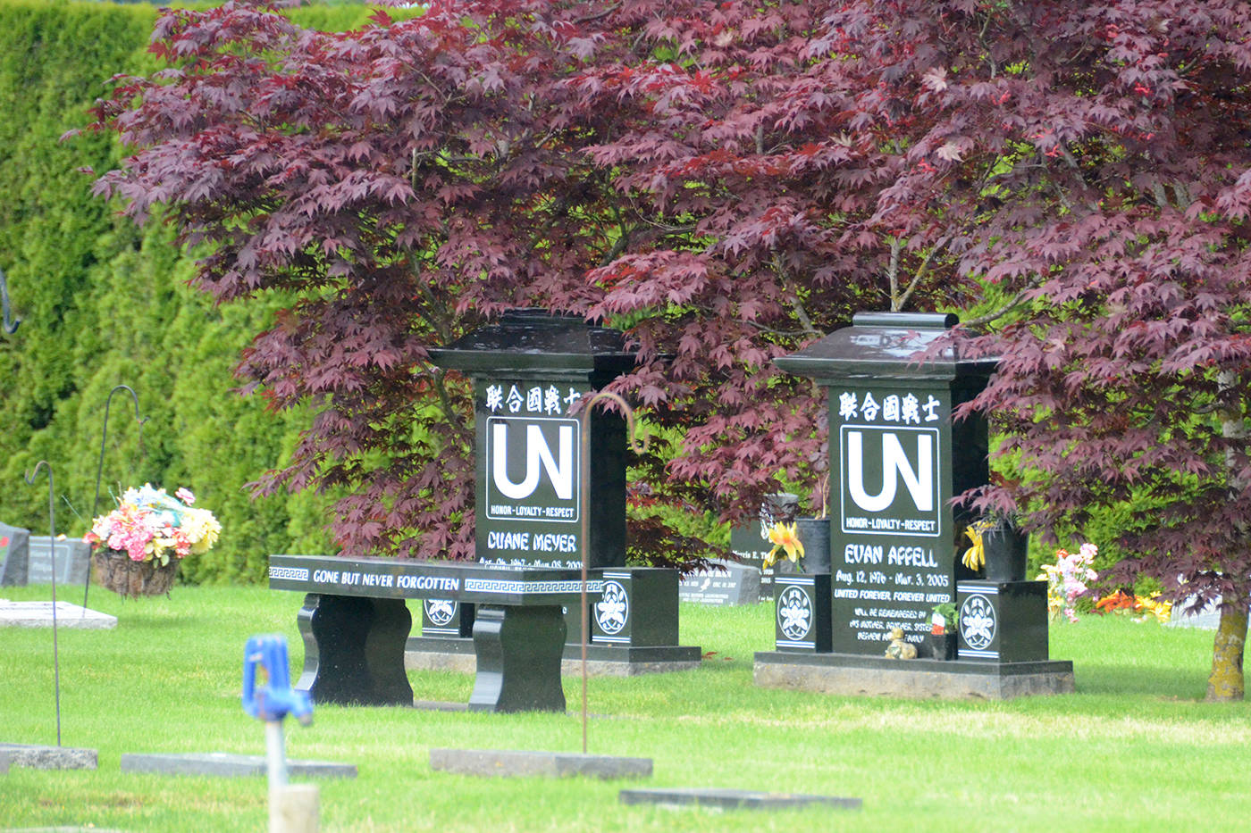 The grave sites of United Nations gang members Duane Meyer and Evan Appell on June 16, 2020 in Vedder View Gardens Cemetery in Chilliwack. There were two lion statues at the grave site that went missing since April. (Paul Henderson/ The Progress)