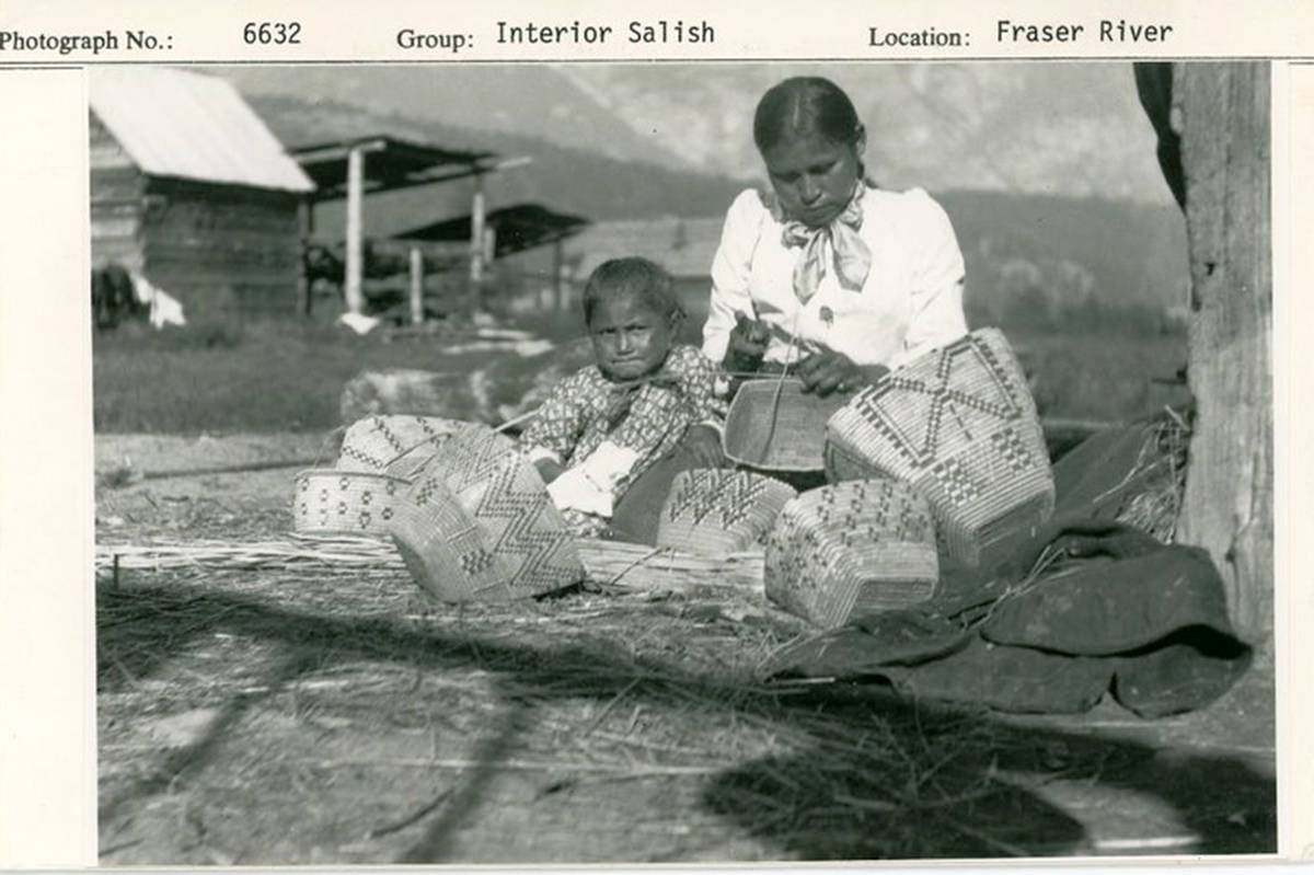 An Interior Salish woman and child with baskets sit along the Fraser River. Royal BC Museum recently digitized 16,103 historical photographs depicting Indigenous communities. (Royal BC Museum/Special to Langley Advance Times)