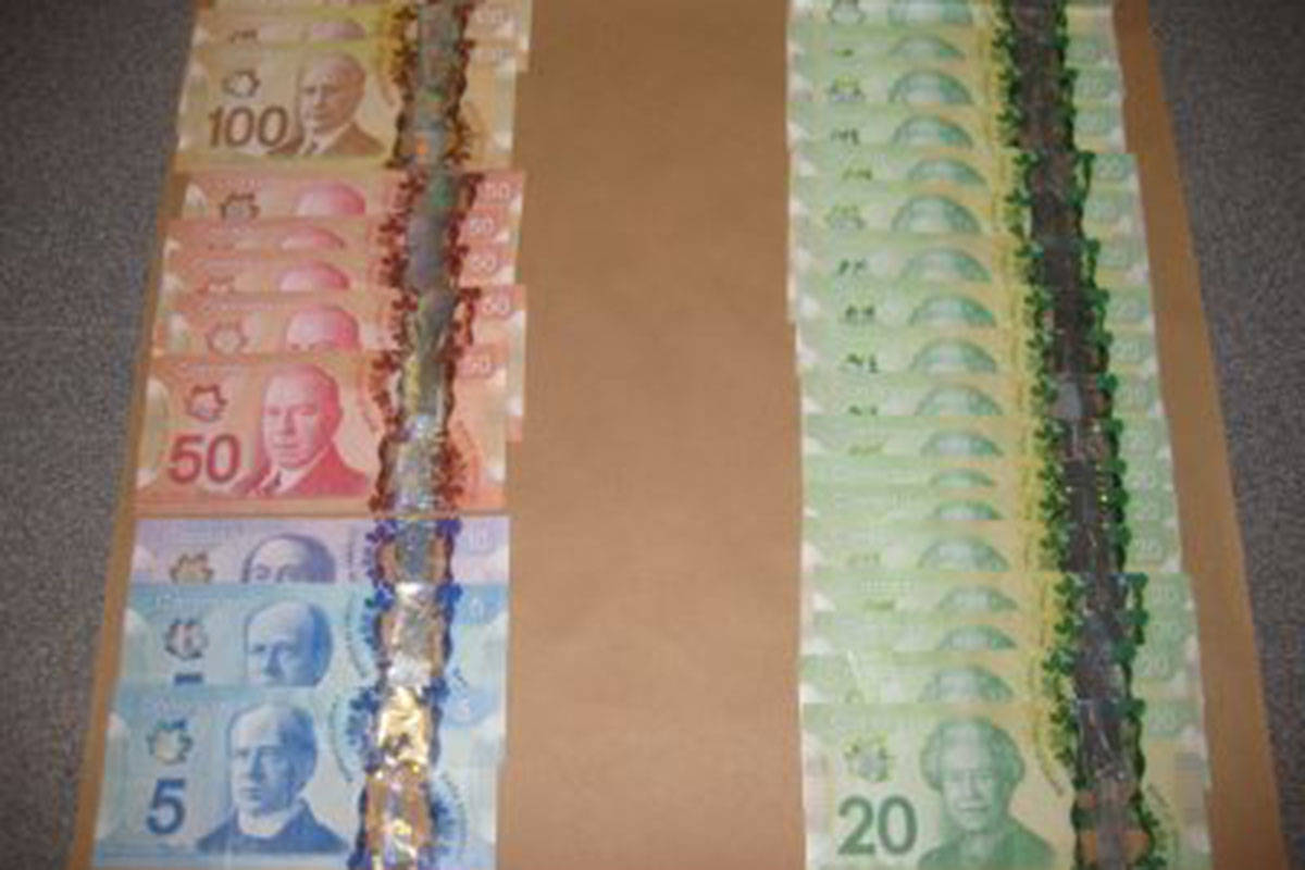 Langley RCMP seized suspected drugs and cash, along with guns, during a recent search in Surrey. (Langley RCMP)