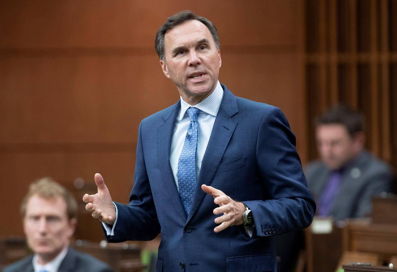Finance Minister Bill Morneau rises during Question Period in the House of Commons Tuesday May 26, 2020 in Ottawa. The Canadian Association of Petroleum Producers says if bridge loans for smaller oil and gas companies aren't ready to flow soon some companies will have to turn to less-safe options to survive the COVID-19 slowdown.THE CANADIAN PRESS/Adrian Wyld
