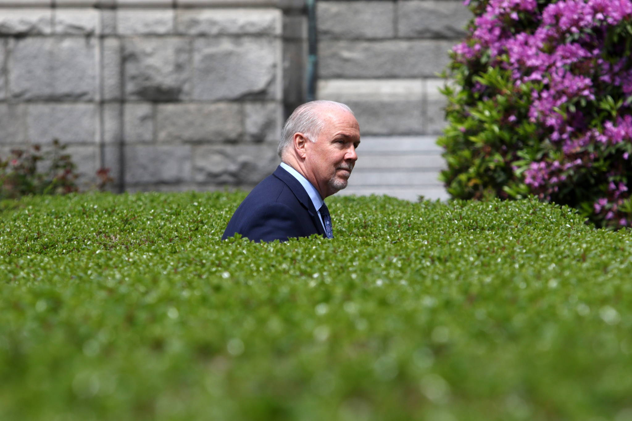 Premier John Horgan leaves the podium following the latest update on the COVID-19 response in the province during a press conference from the rose garden at Legislature in Victoria, B.C., on Wednesday June 3, 2020. THE CANADIAN PRESS/Chad Hipolito
