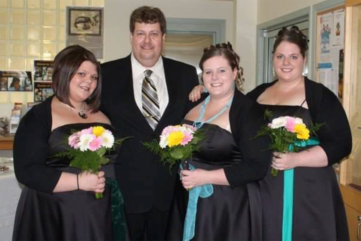 Suzanne Van't Haaff entered this for her daughters Tiffany, Robyn, and Vicky. They think their Stepdad Lloyd should win the contest because he is the best. He chose to have them in his life when he married their mum. He always goes the extra mile for them and they love him. He never had children of his own and loves being stepdad. This picture was taken the day we got married. Left is Vicky, Lloyd Tiffany and then Robyn to the right side. They stood up for us to sign the witness at the wedding. It made our day. They would love to take Lloyd out for supper for Father's day to Me-n- Ed's, his favorite pizza place:) Thank you for the opportunity